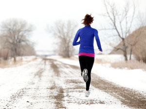 woman-running-snowy-dirt-road-mdn
